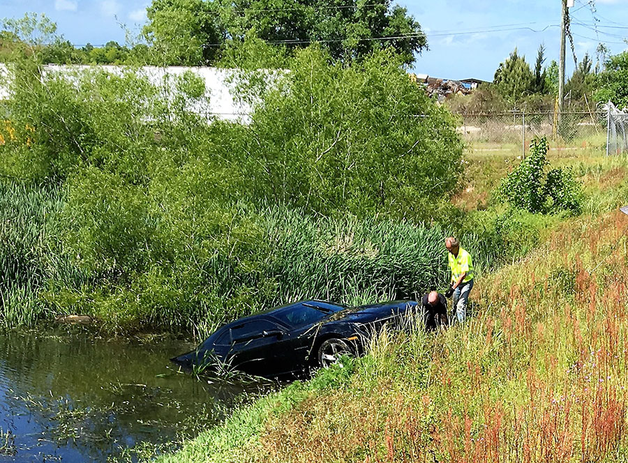 Car in a county holding pond