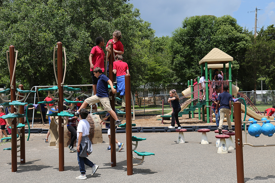 Children play on the playground at Old Ensley Park.
