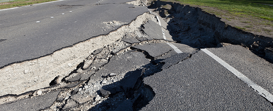A cracked roadway after an earthquake.