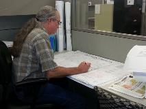 Survey Staff Member Working on Plat Review