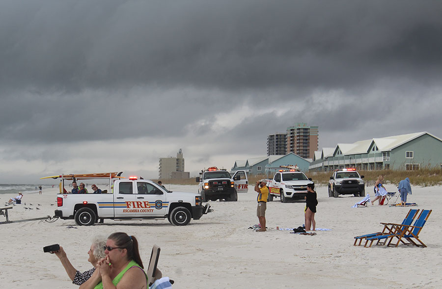 Lifeguards performing a rescue on Pensacola Beach